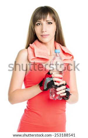 Young athlete woman with towel holding bottle with water. Pretty fitness girl isolated on white background - stock photo
