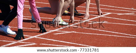 Young athletes at the start of sprint - stock photo