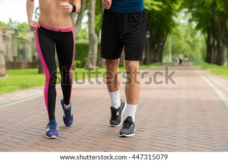 Young athletes running in the nature - stock photo