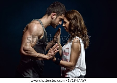 young athletic couple in studio - stock photo