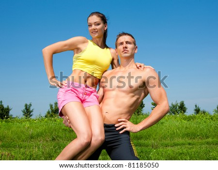 young athletic couple in the sky - stock photo