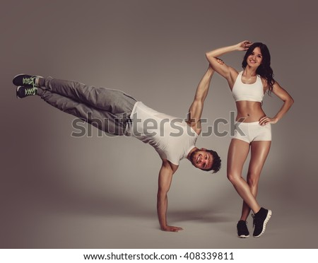 Young athletic couple, studio shot - stock photo