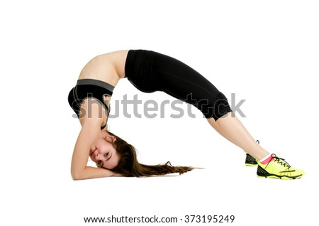 Young athletic flexible woman arching on a floor, isolated on white