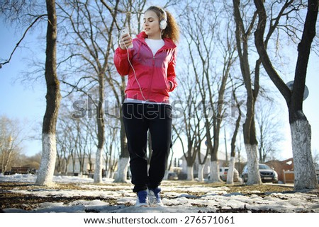 young athletic girl on a walk in the park - stock photo
