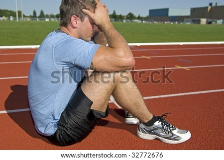 Young Athletic Male loses the race - stock photo