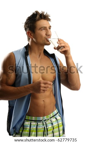 Young athletic man drinking water - stock photo