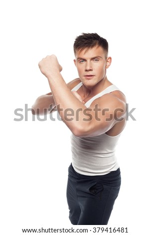 young athletic man standing in fighting stance