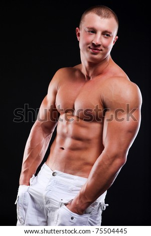 Young athletic man with perfect body of bodybuilder - stock photo