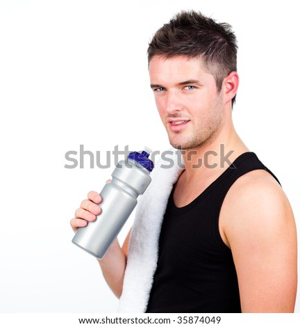 Young athletic young man holding a sports bottle - stock photo