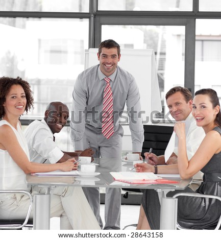 Young Attracitve Businessman giving a presentation - stock photo