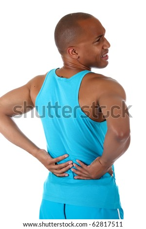 Young attractive African American man athlete suffering from back pain. White background. Studio shot. - stock photo