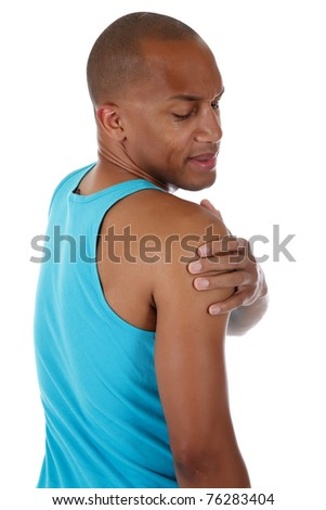 Young attractive African American man athlete suffering from pain in the shoulder. White background. Studio shot. - stock photo