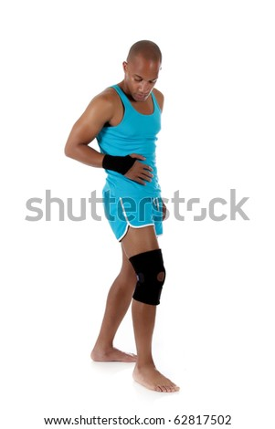 Young attractive African American man athlete wearing a wrist brace and knee support,  bandaged. White background. Studio shot. - stock photo