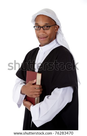 Young attractive African American man in sheikh posture dressed in arab garb, holding a book. Studio shot . White background - stock photo