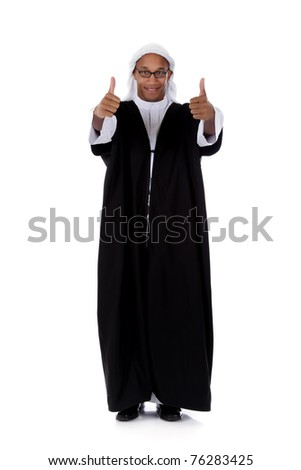 Young attractive African American man in sheikh posture dressed in arab garb, thumbs up. Studio shot . White background - stock photo