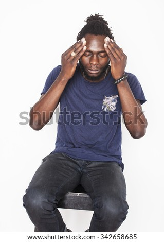young attractive african american man isolated thinking emotional on white close up, holding head - stock photo