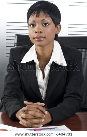 Young attractive african business woman in a modern office setting - stock photo
