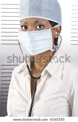 Young attractive african doctor with face mask and stethoscope