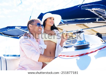 Young, attractive and rich couple have a party on a luxury boat