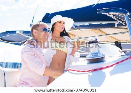 Young, attractive and rich couple have a party on a luxury sailing boat at summer - stock photo