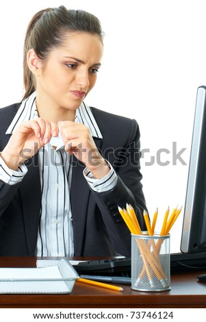 young attractive angry office worker, trying to tear some papers, isolated on white - stock photo