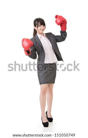 Young attractive asian business woman with boxing gloves are ready for battle. Isolated on the white background. - stock photo