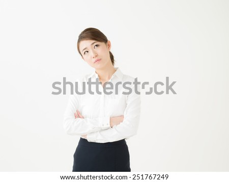young attractive asian businesswoman who is troubled - stock photo