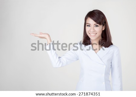 Young attractive asian nurse - stock photo