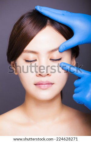 young attractive asian woman face - stock photo