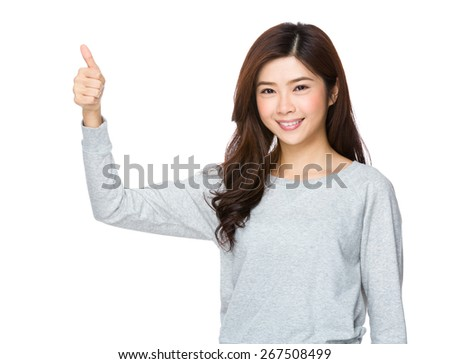 Young attractive asian woman giving thumbs up sign - stock photo