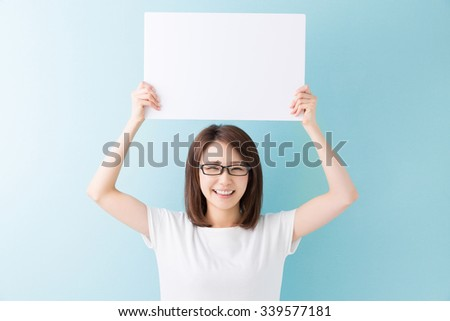 young attractive asian woman having a white board - stock photo