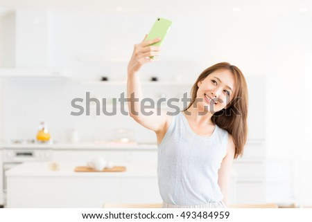 young attractive asian woman taken pictures of her self