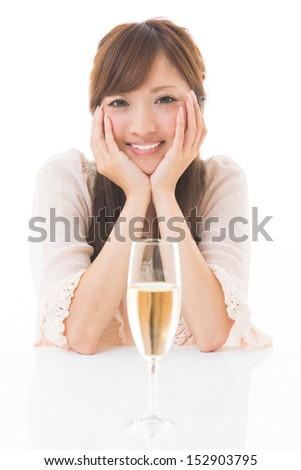 young attractive asian woman who drinks wine - stock photo