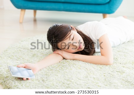 young attractive asian woman who sleeps - stock photo