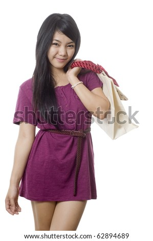 Young attractive Asian woman with shopping bags - stock photo