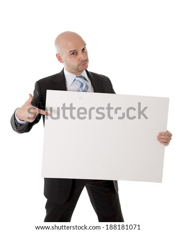 young attractive bald business man wearing suit and necktie holding blank white advertisement sign or billboard for adding message text as copy space isolated on white background - stock photo