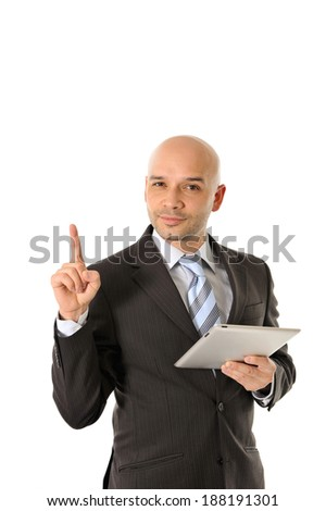 young attractive bald business man wearing suit and necktie pointing copy space for text message or advertising holding tablet isolated white background