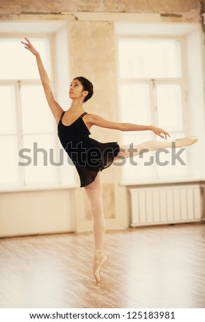 Young attractive ballerina in a dance class - stock photo