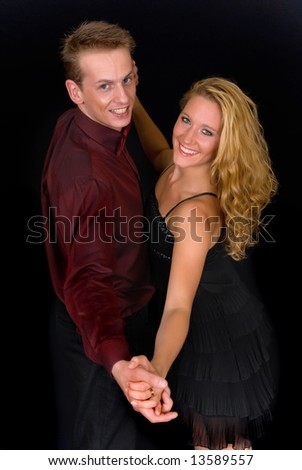 Young attractive ballroom dancers, man and woman.  Studio shot.