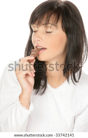 Young attractive beautiful woman eating chocolate on white background - stock photo