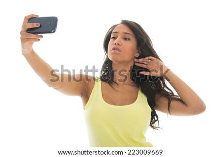 Young attractive black woman is taking a selfie with her cellphone isolated over white background - stock photo