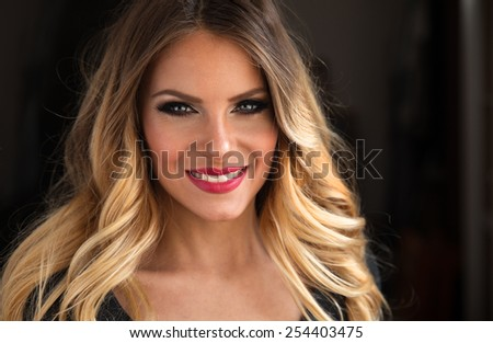 Young attractive blond hair woman portrait.Not retouched.Natural light. - stock photo