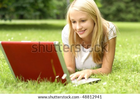 Young attractive blond is relaxing in the park - stock photo
