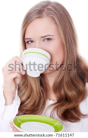 Young attractive blond woman drinking coffee - stock photo