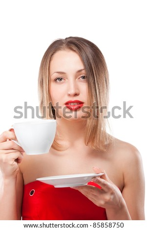 Young attractive blond woman drinking tea - stock photo
