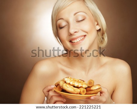 young attractive blond woman with cookies