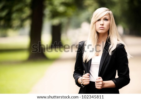 Young attractive blonde standing - stock photo