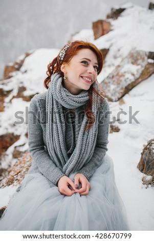Young attractive bride over snowy background - stock photo