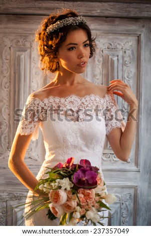Young attractive bride with flowers - stock photo