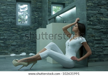 Young attractive brunette fashion model - stock photo